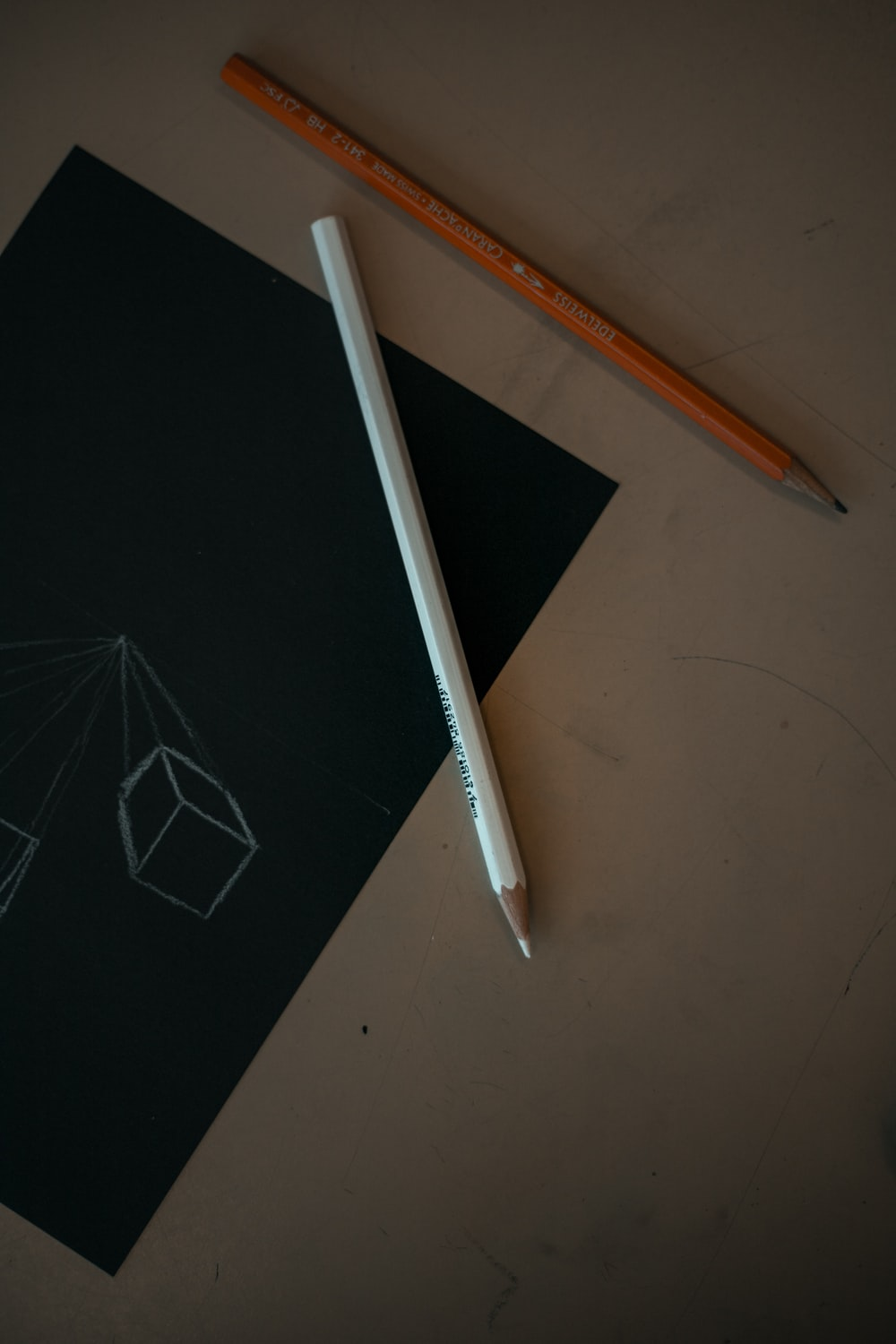 white pencil on black surface