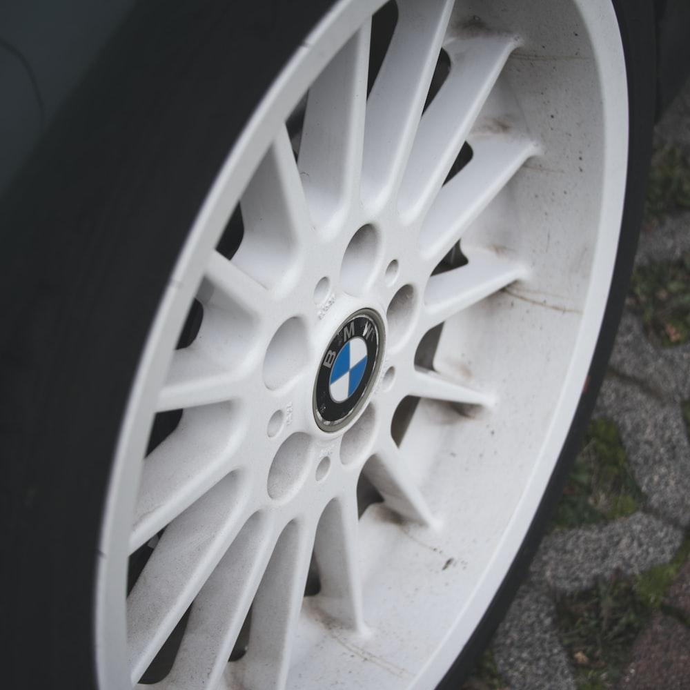 white 5 spoke wheel with tire