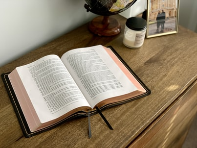 An ESV Bible sits open on a table.
