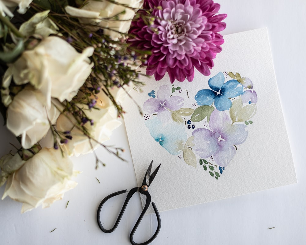 purple and white flowers on white paper