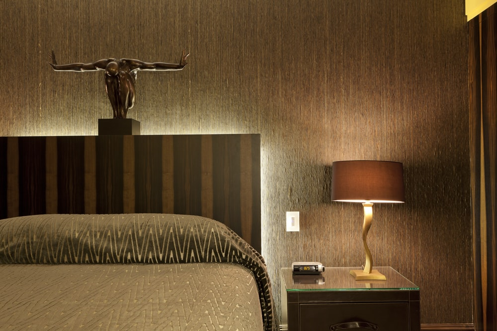 brown and white table lamp on brown wooden nightstand