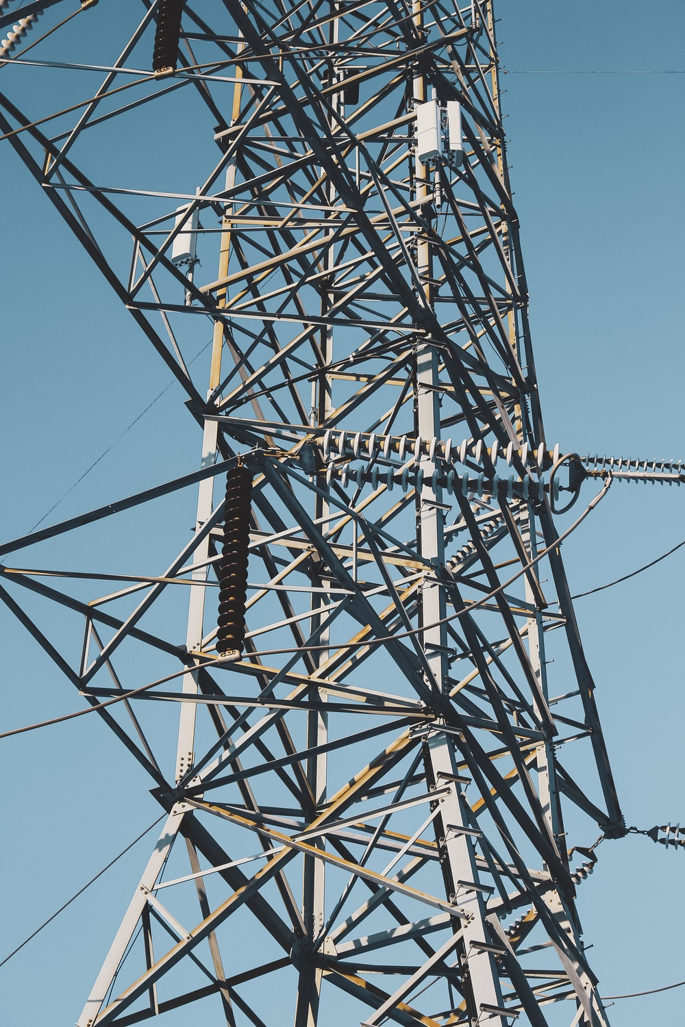 black electric tower under blue sky during daytime