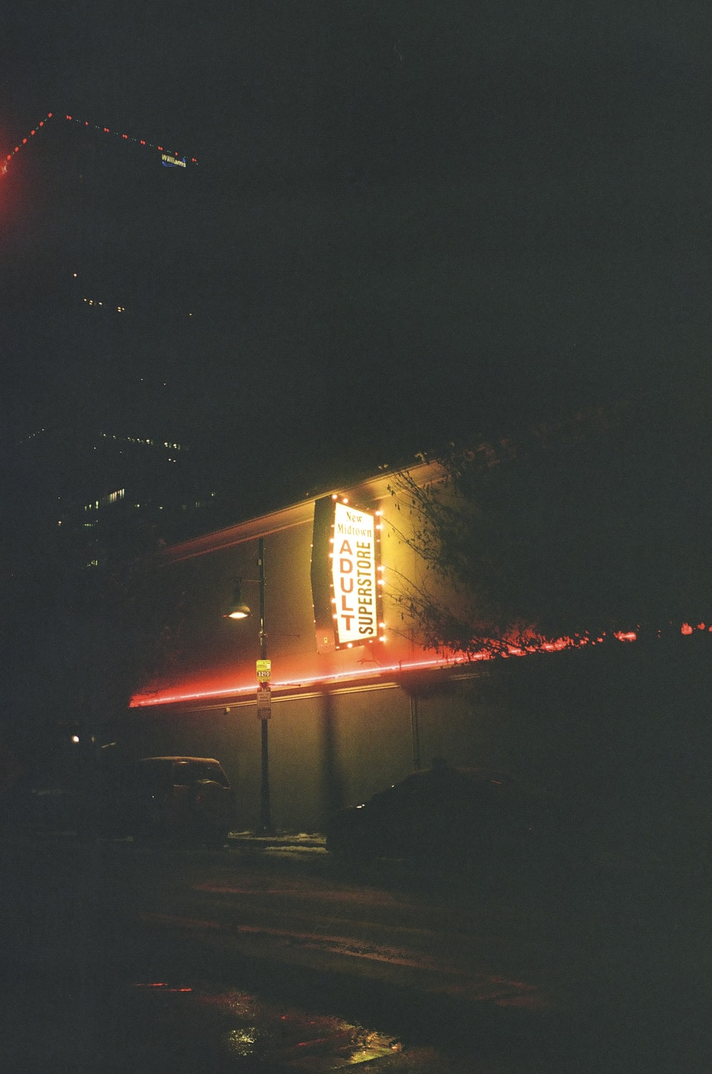 white and red lighted building during night time