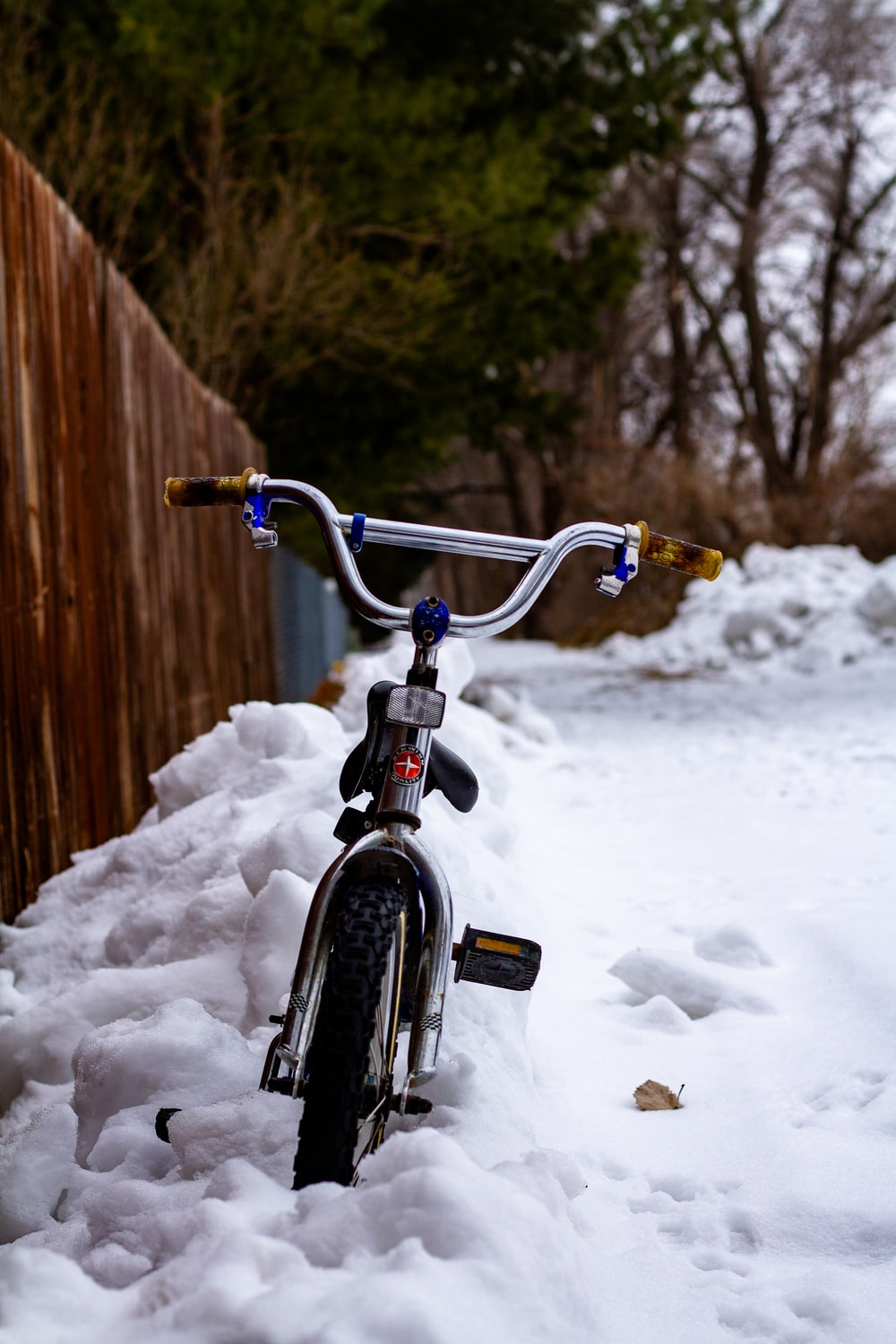 black and gray bicycle on snow covered ground during daytime