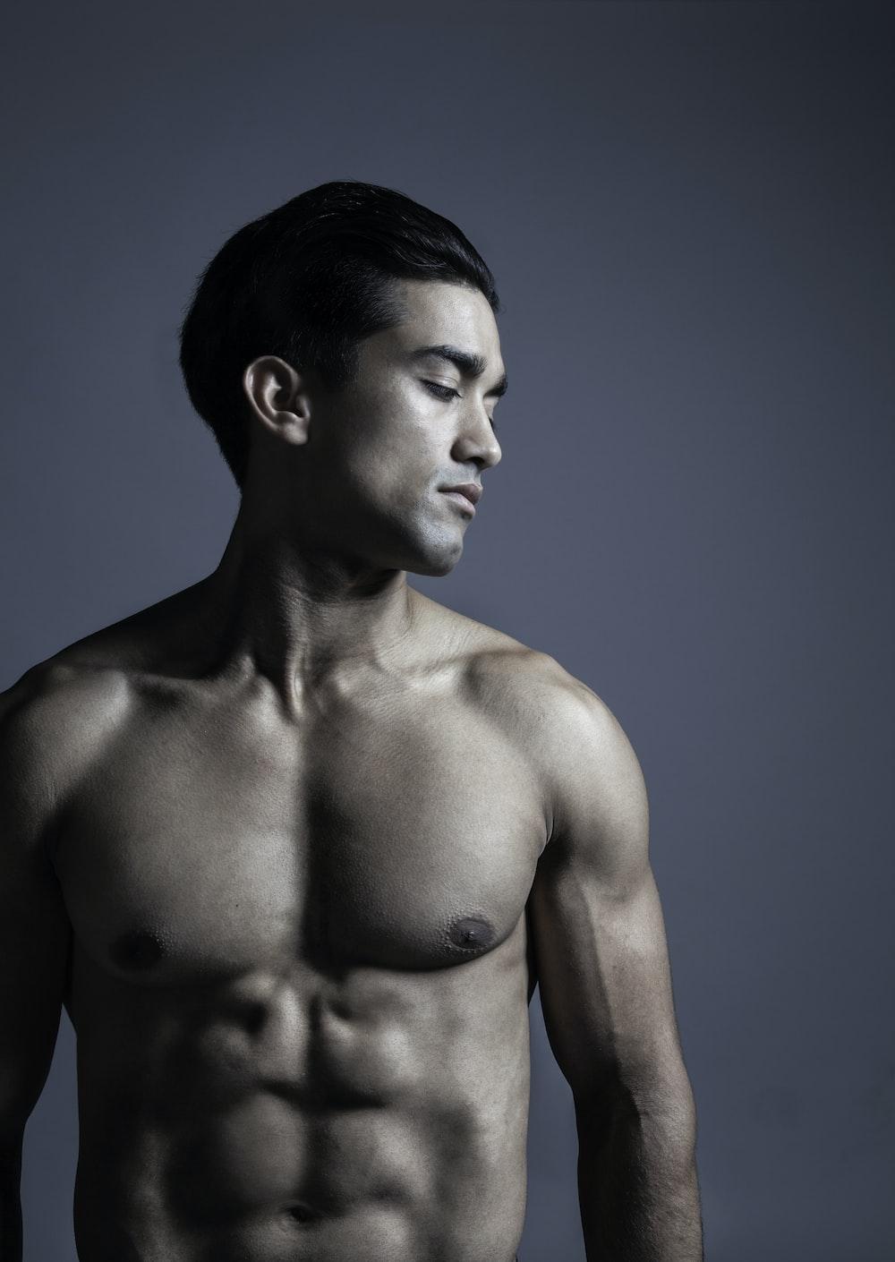 topless man in blue denim bottoms