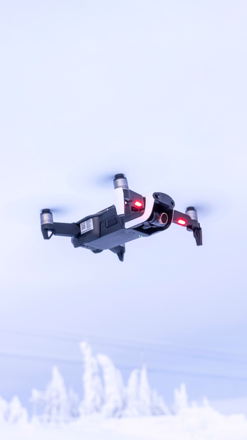 black and red drone flying