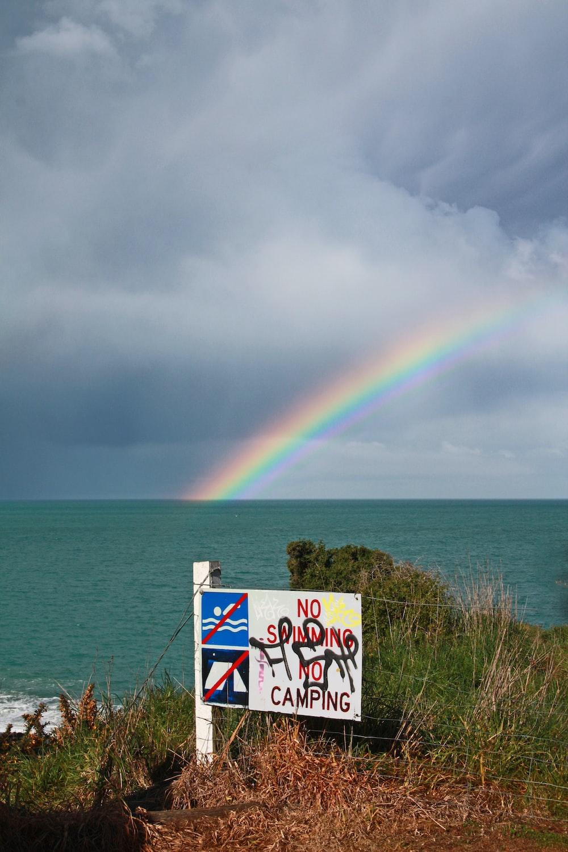 rainbow over body of water