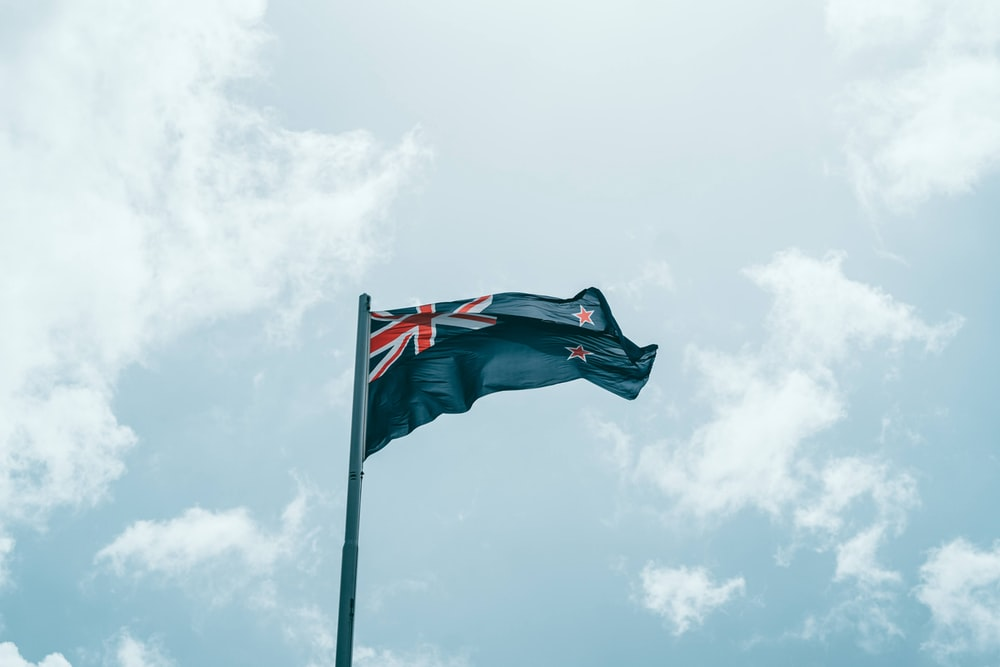 us a flag on pole under cloudy sky