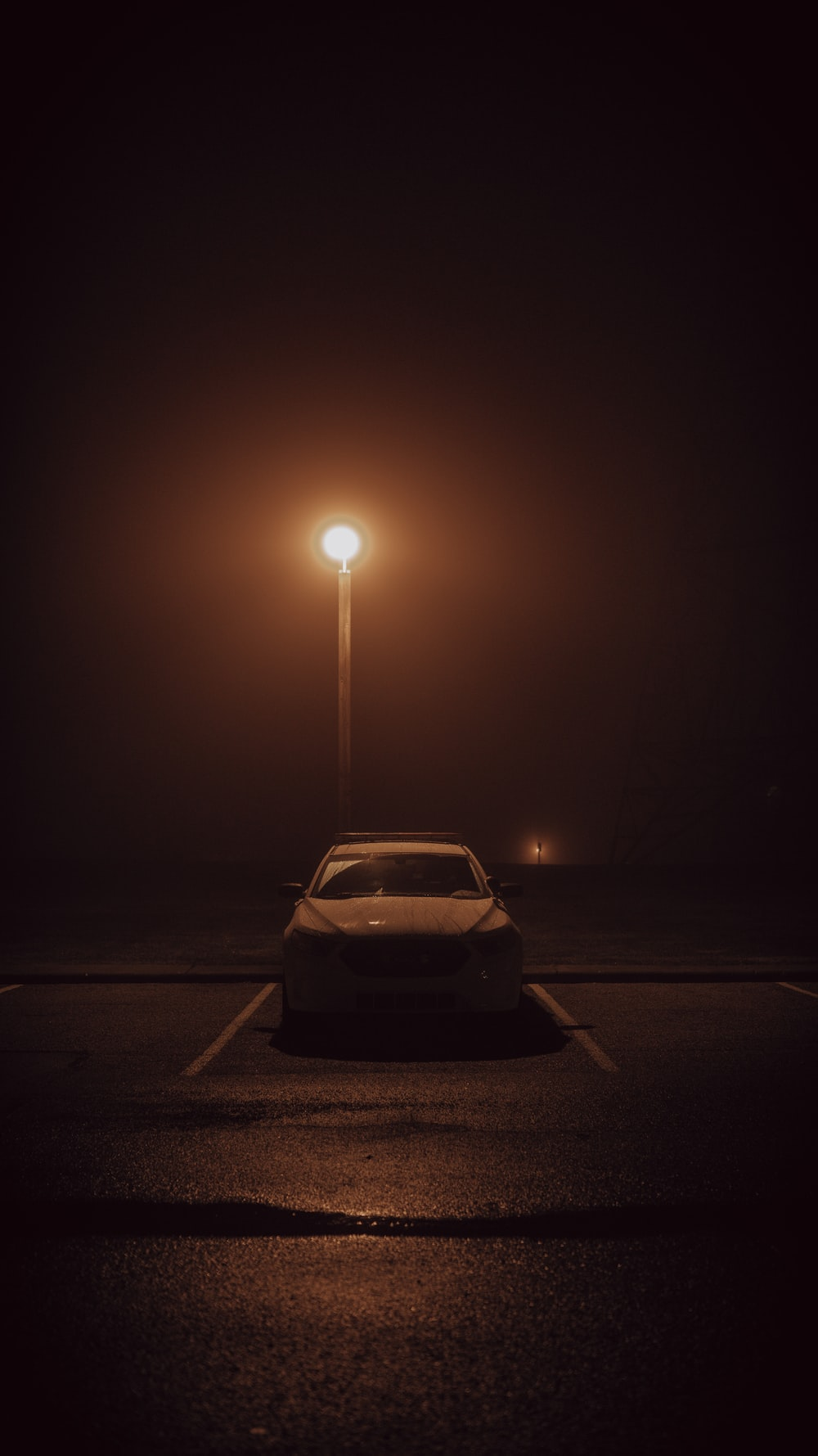 white car on road during night time