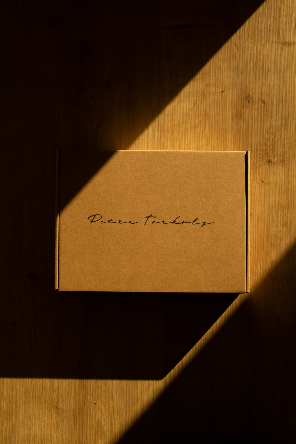 brown cardboard box on brown wooden table