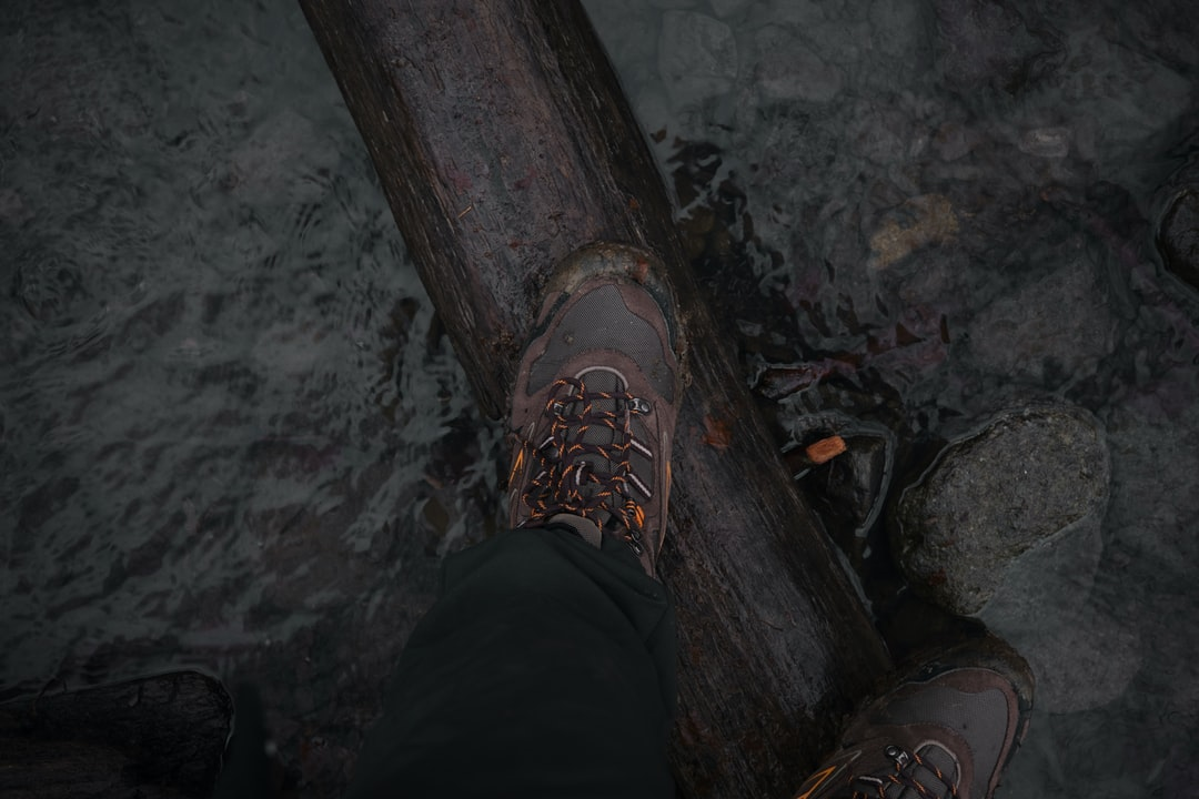 Rivercrossing In Hiking Boots - unsplash