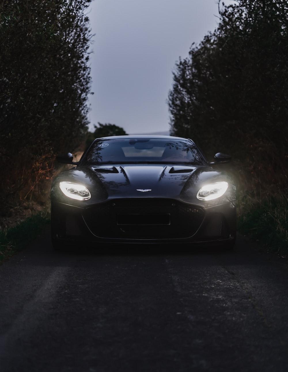 black bmw m 3 on road during night time