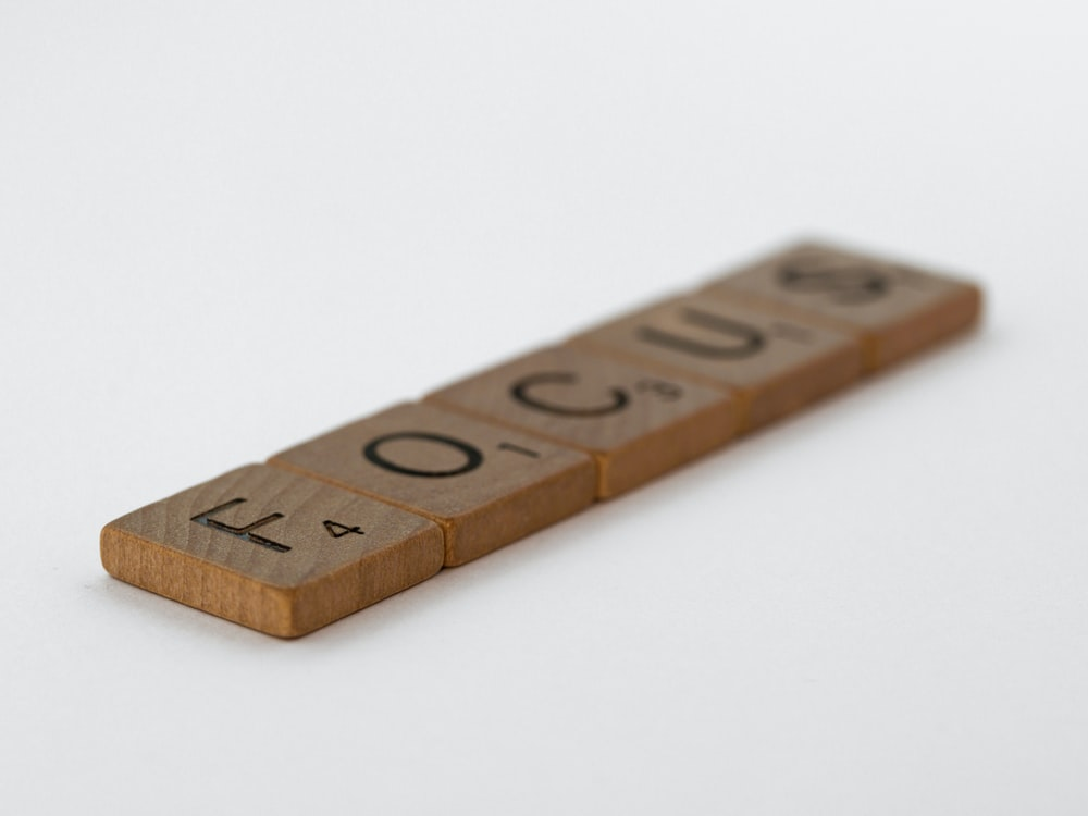 brown wooden letter t-embossed decor
