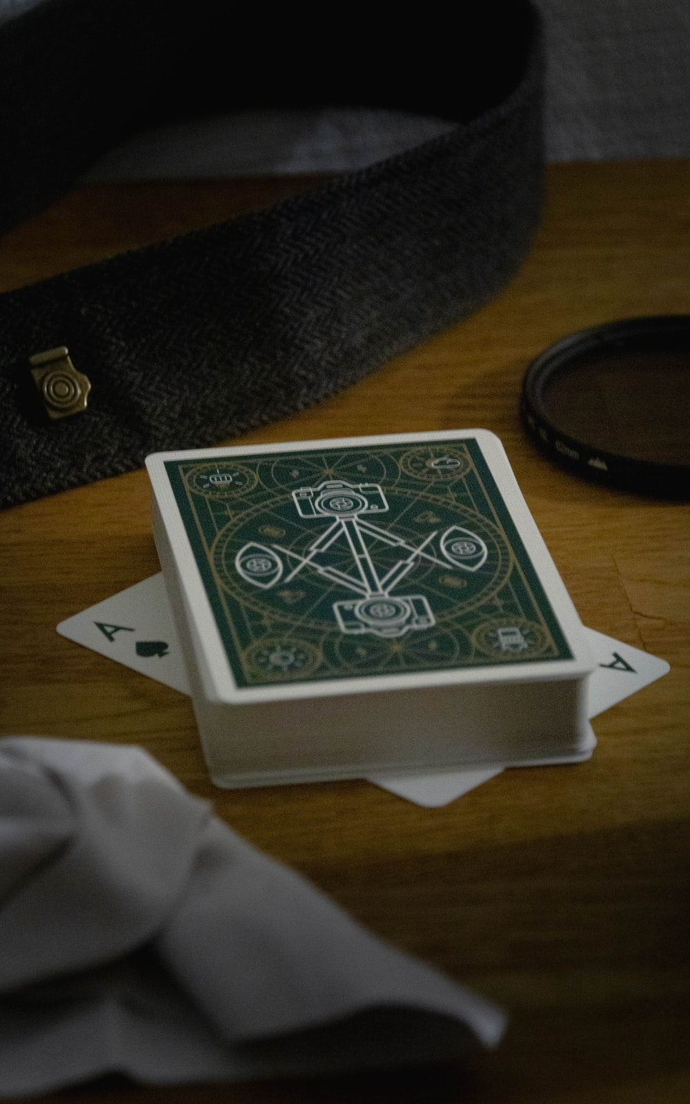 green and white playing card on white box