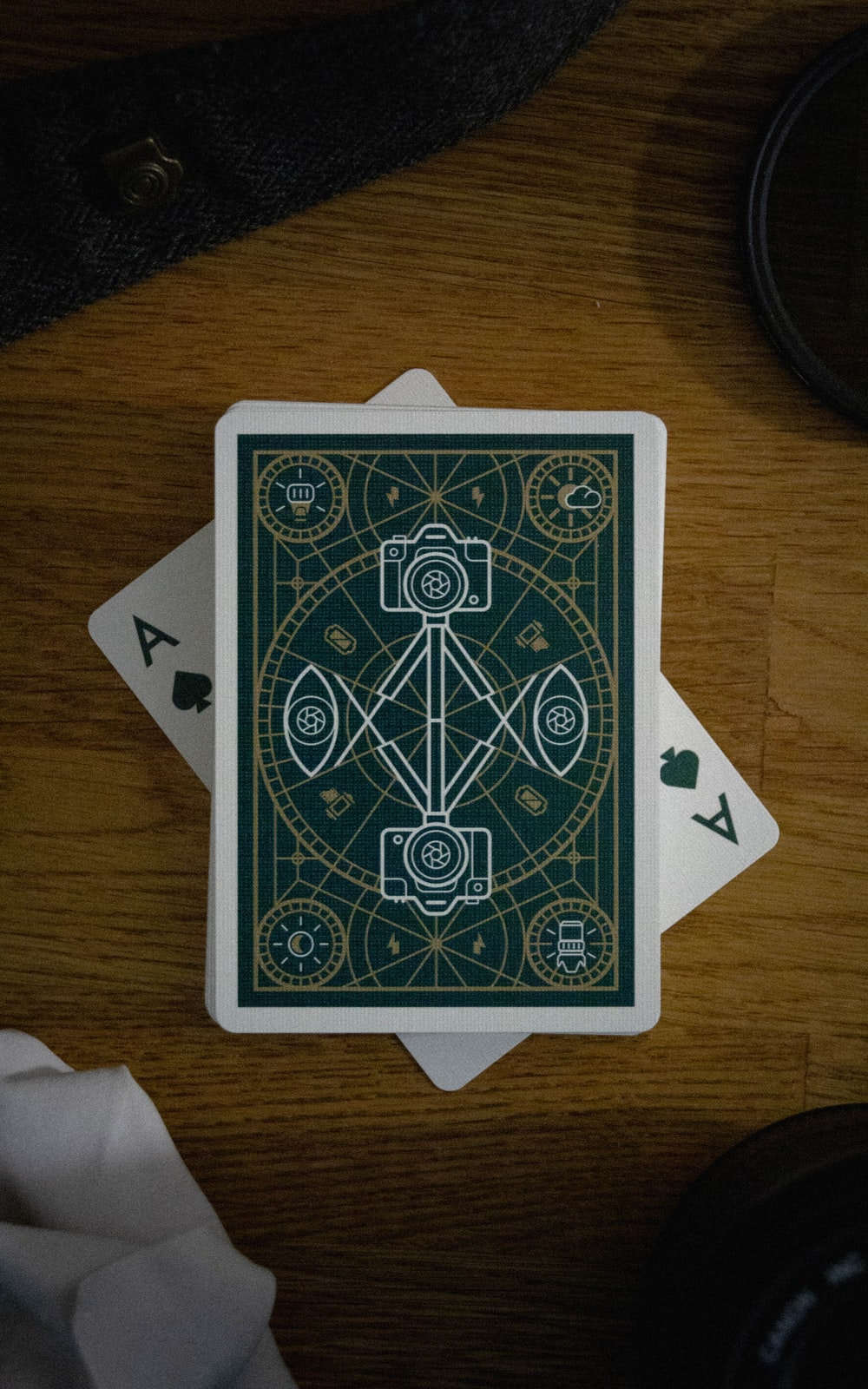 green and white playing card on brown wooden table