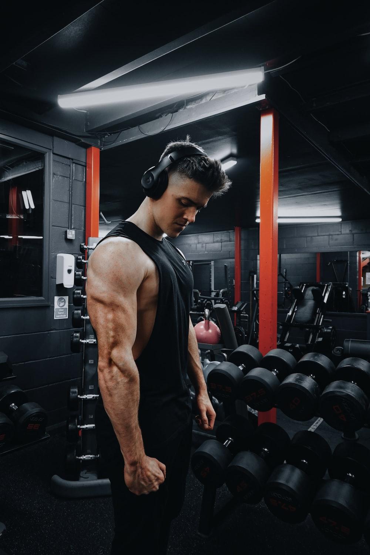 man in black tank top wearing black headphones
