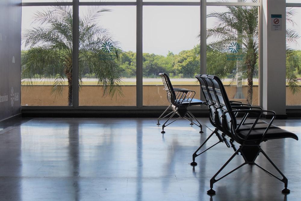 black metal framed chairs on white floor tiles