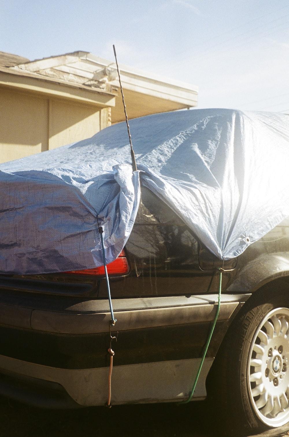 black car with blue umbrella