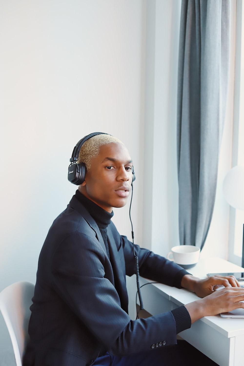 man in black dress shirt wearing headphones