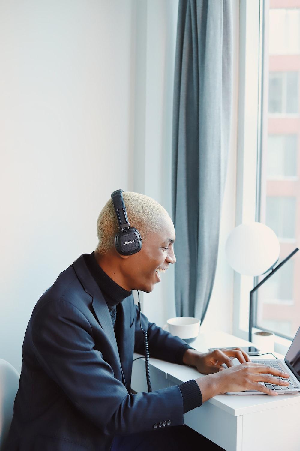 man in black jacket wearing headphones