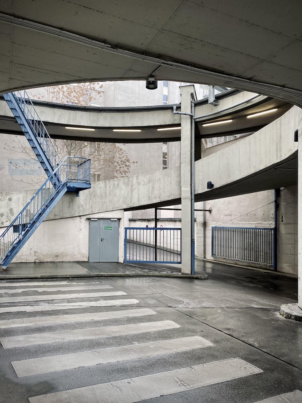 blue metal railings on gray concrete floor