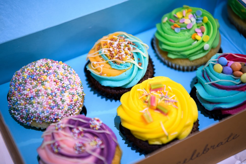 cupcakes with assorted color icing on top