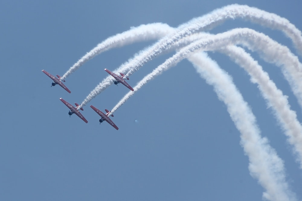 four red jet planes in mid air