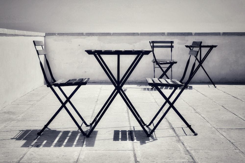 black metal folding chairs on gray concrete floor
