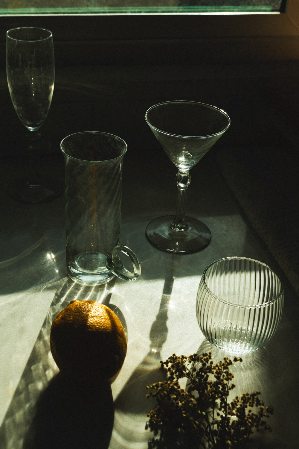 clear wine glass beside clear glass bowl