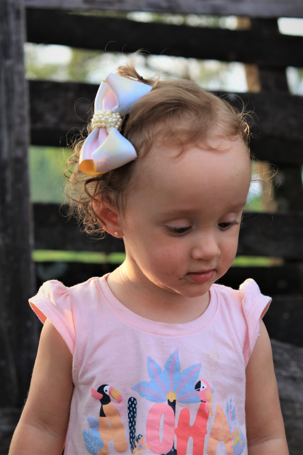 girl in pink tank top with white and yellow butterfly headband