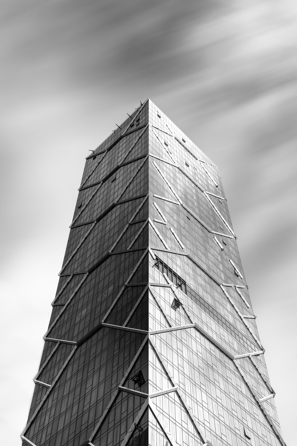 gray scale photo of pyramid