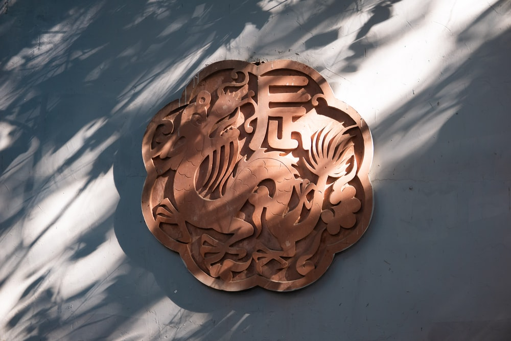 brown wooden heart shaped carved decor
