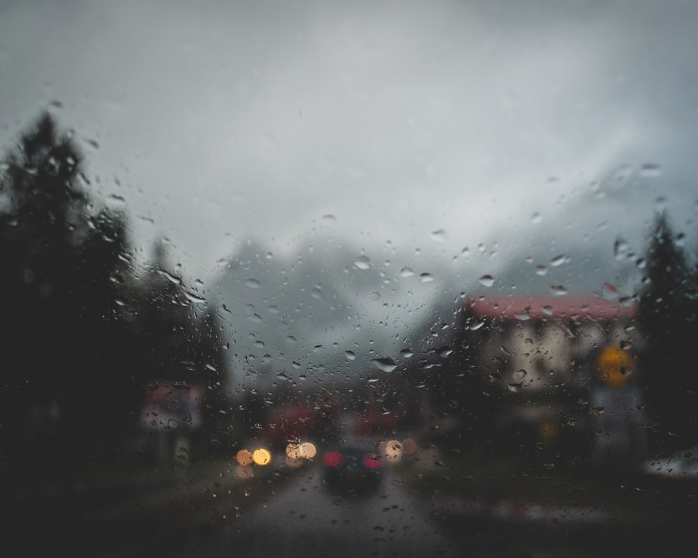 black car on road during rainy day