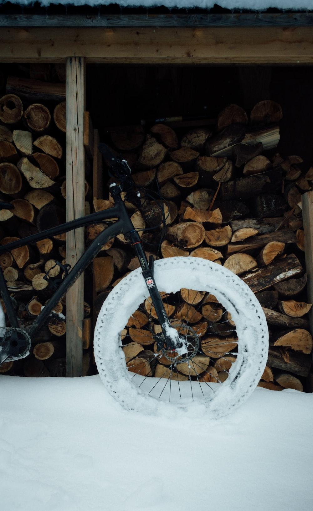 black bicycle wheel on white round textile