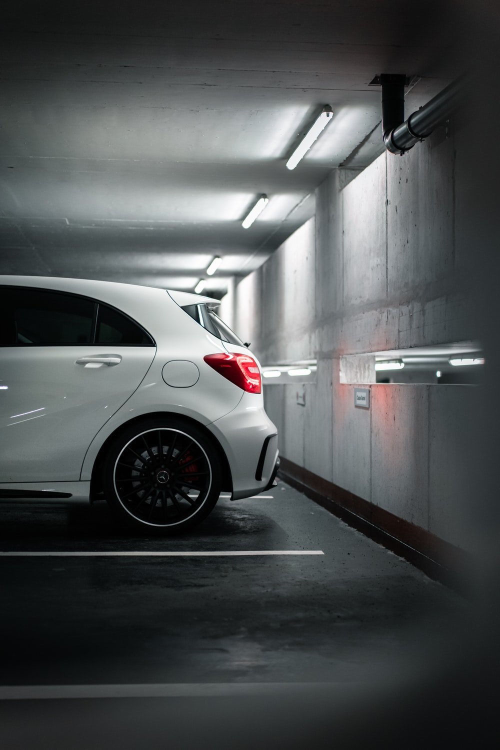 white car in a tunnel