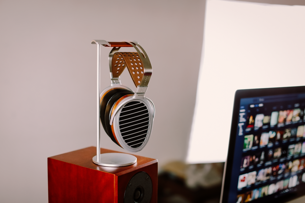 brown and silver speaker beside black flat screen computer monitor