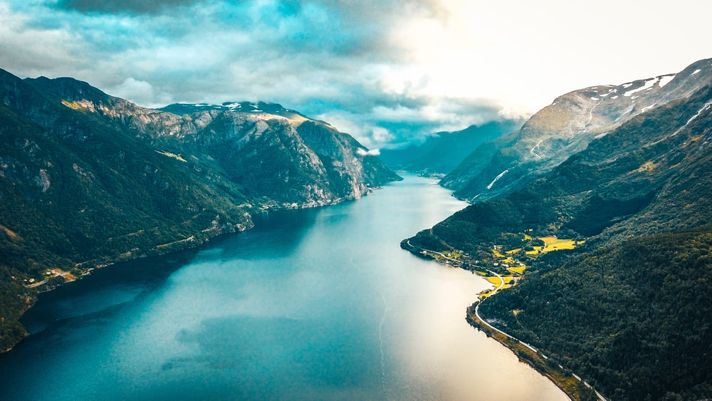 aerial view of lake between mountains during daytime