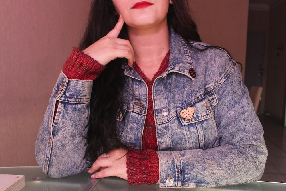 woman in blue denim button up jacket