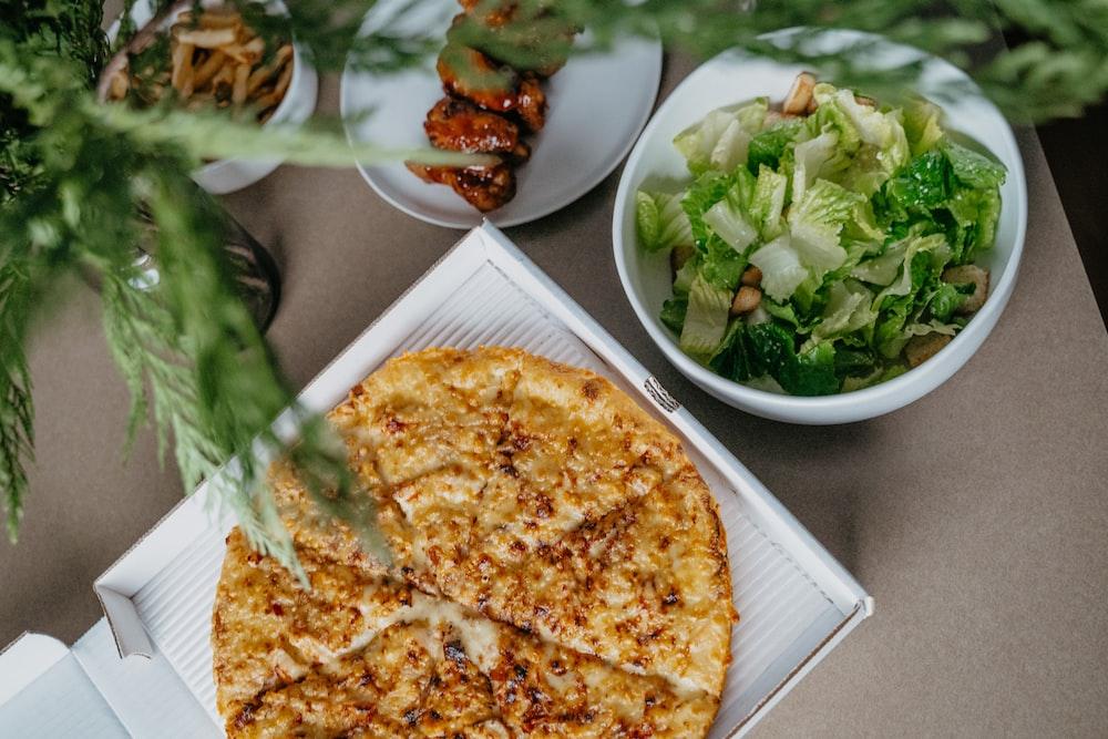 pizza on white ceramic plate