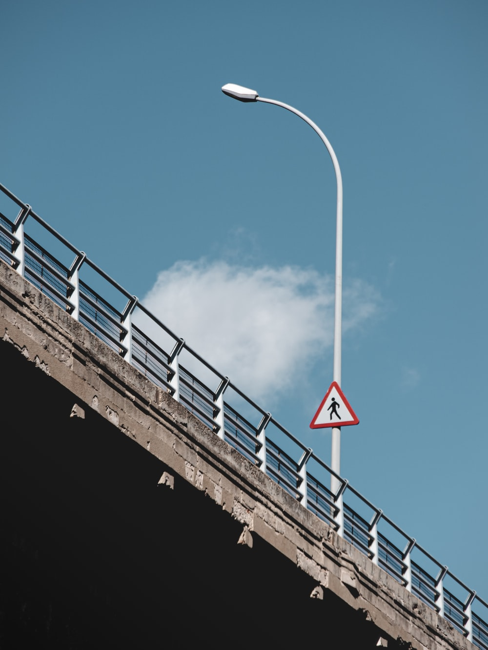 white and red bridge under blue sky during daytime