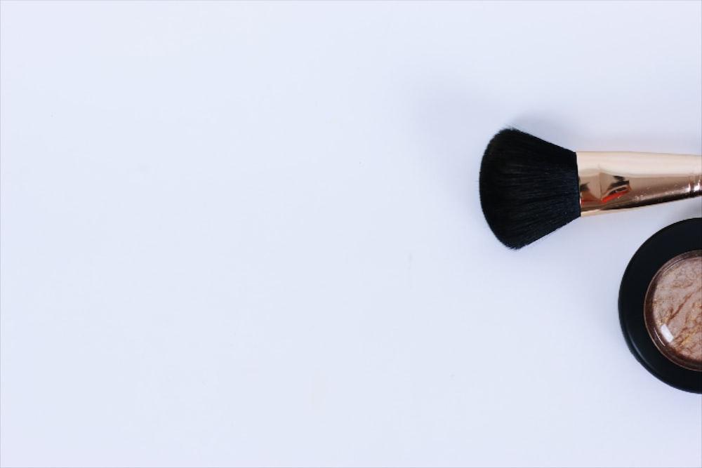 black brush on white surface