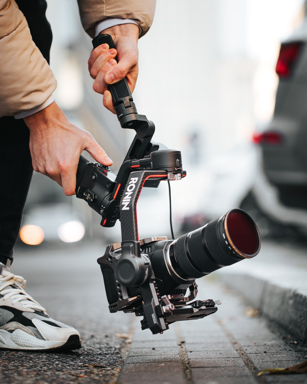 person holding black and red dslr camera