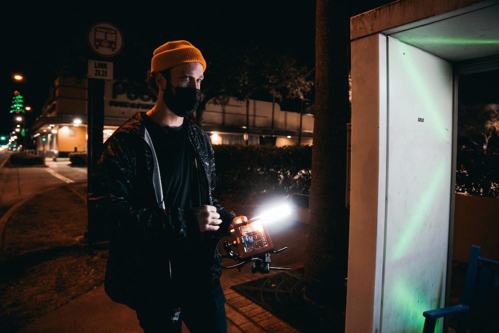 man in black shirt standing beside man in black shirt photo – Free Lighting  Image on Unsplash