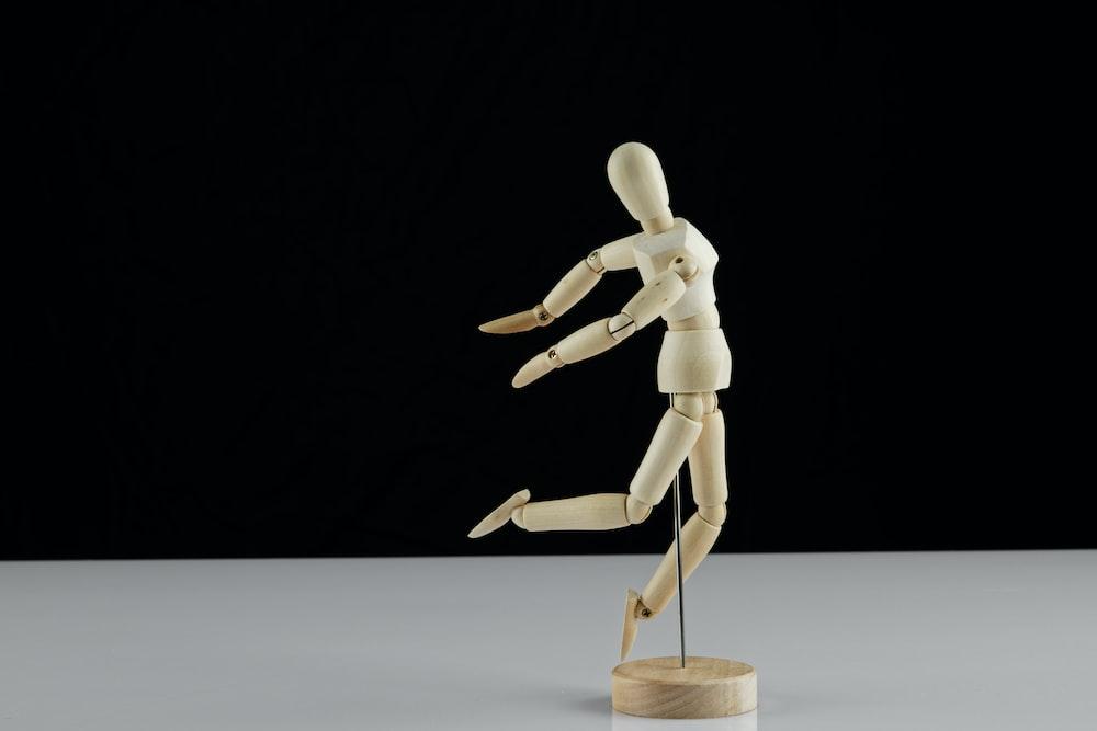 white human figure on white table