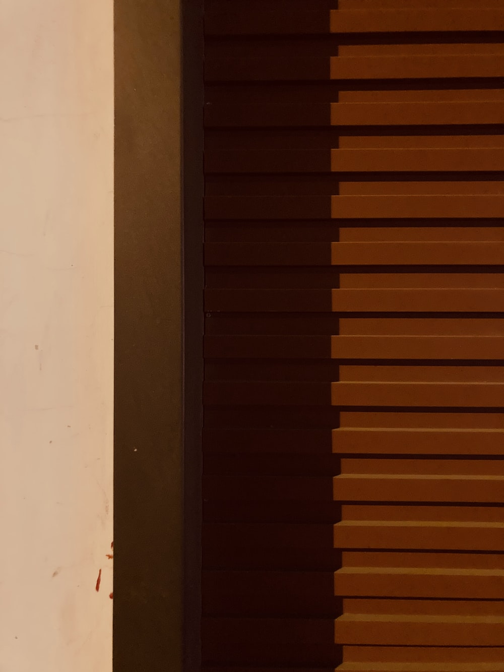 brown wooden door on white painted wall