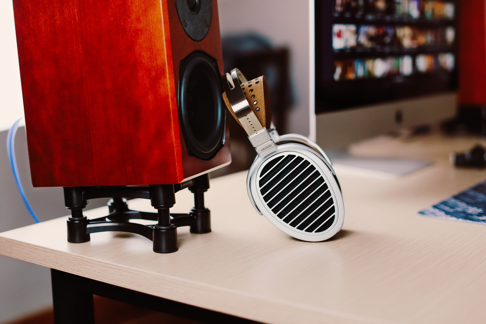 black and red speaker on white table
