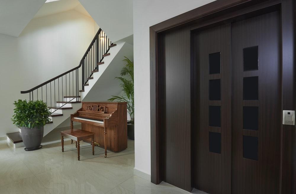 brown wooden bench beside brown wooden door