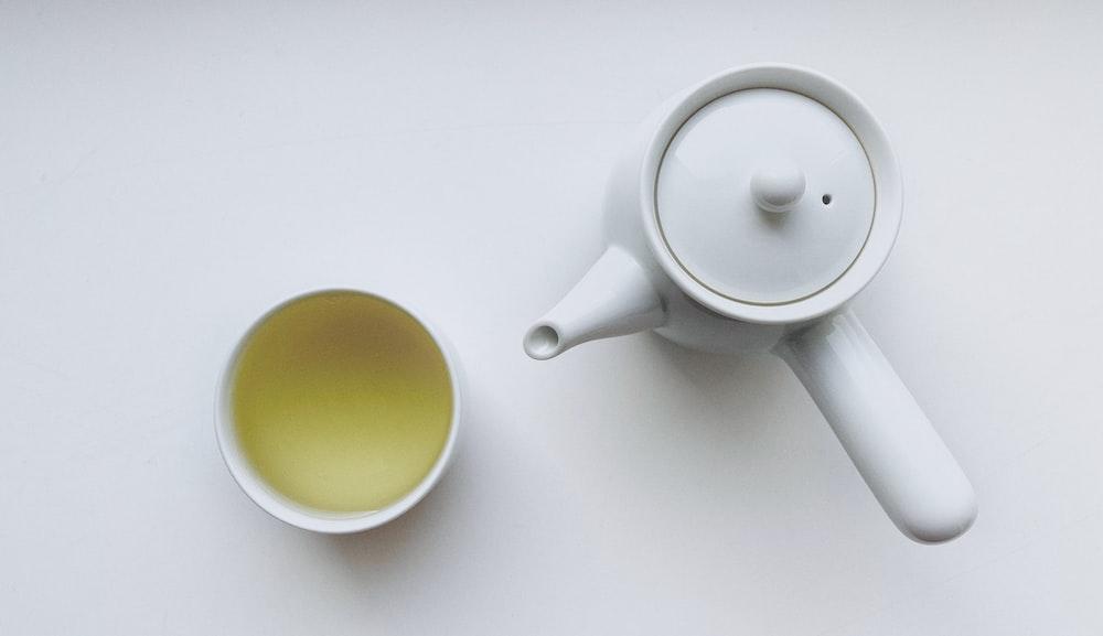 white ceramic teapot beside white ceramic mug