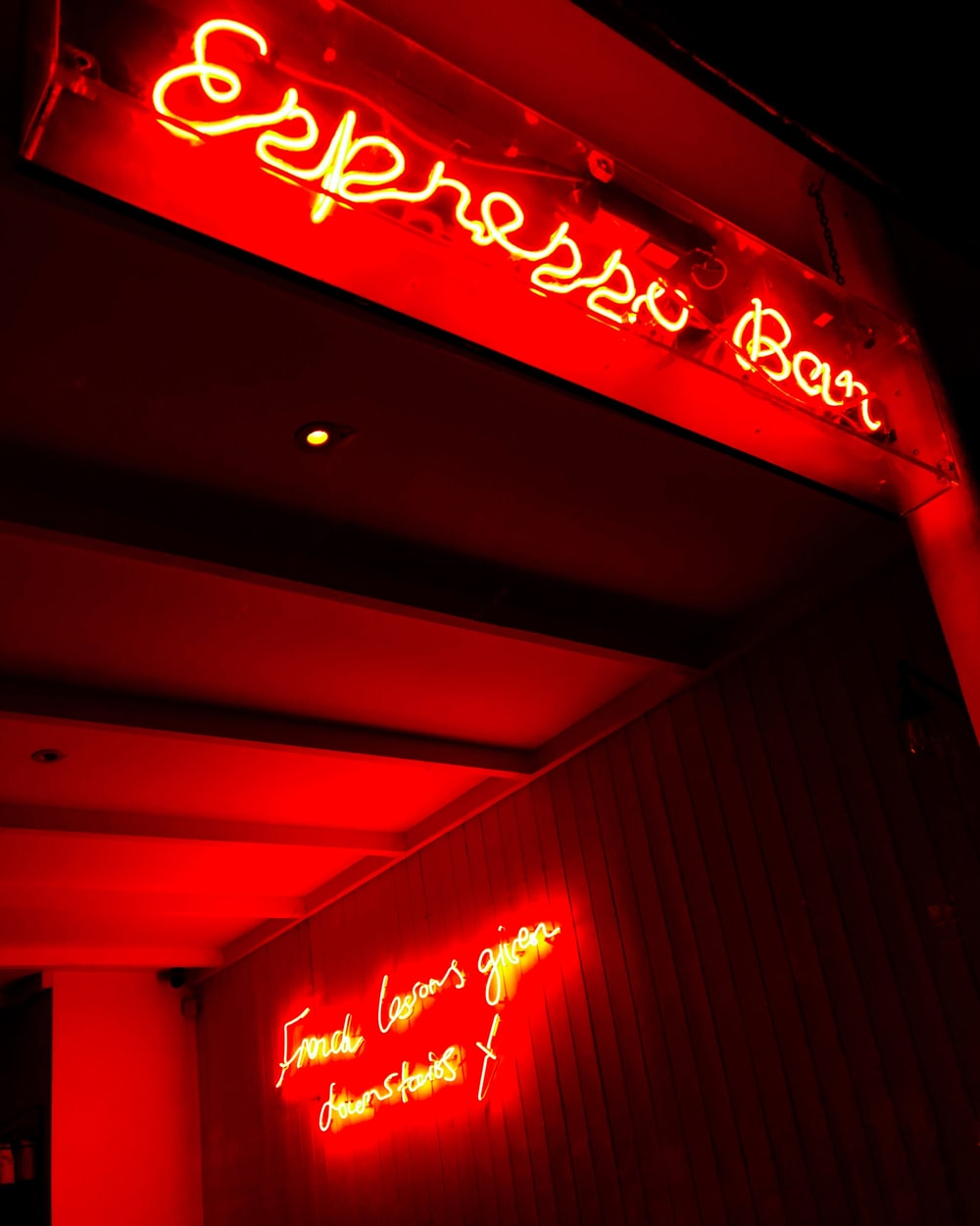 red and white coca cola neon light signage