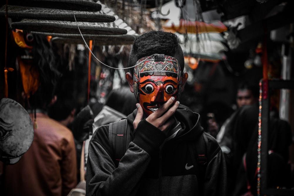 man in black jacket wearing mask
